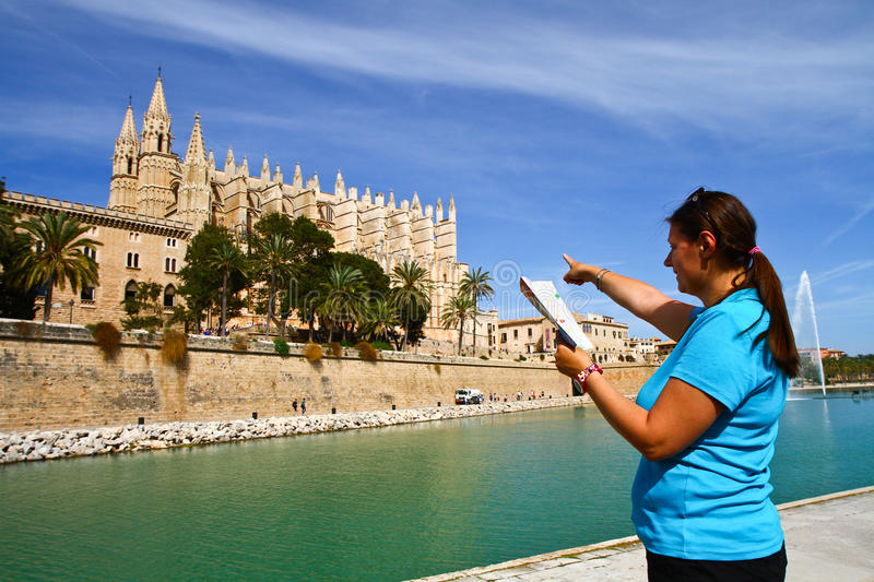 tourist in front of Majorca Palma Cathedral at Balearic Islan stock photos