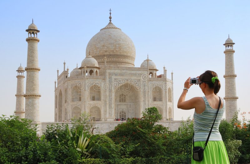 Tourist in front of Taj Mahal royalty free stock photography