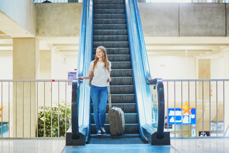 Download Tourist Girl With Backpack And Carry On Luggage In International Airport, On Escalator Stock Photo - Image of student, carry: 83723894