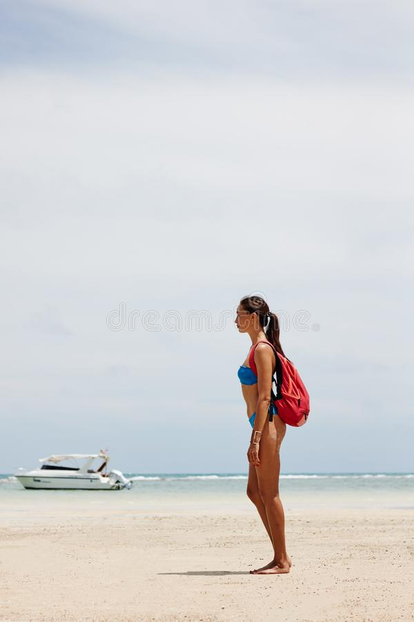 tourist girl with a backpack by the sea stock images