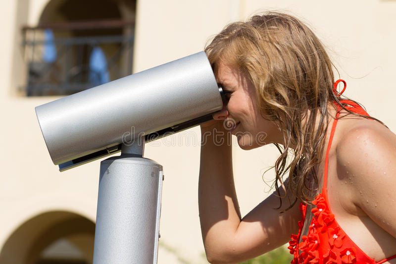 Tourist girl looking in the binocular royalty free stock images