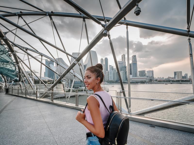 Tourist girl looks at the incredibly beautiful view of the Singapore Bay. Cityscape of the Asian metropolis. Modern buildings and. Structures stock images