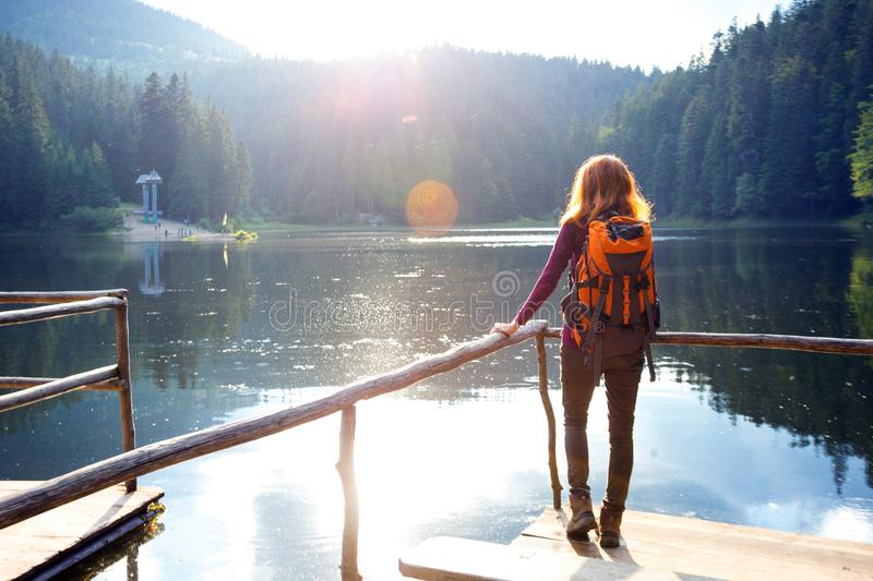 Tourist girl on a mountain lake stock photography