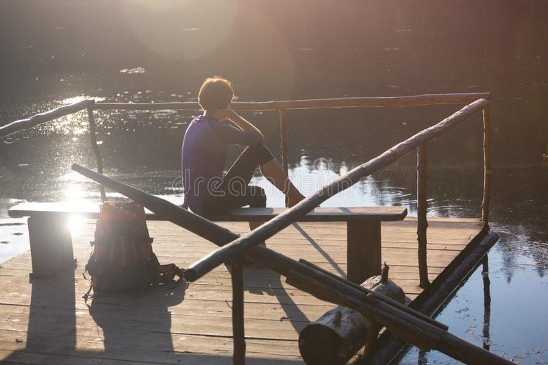 Tourist girl on a mountain lake stock image