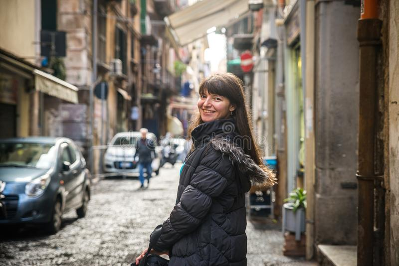 Tourist girl in Naples. On the crowded, busy streets, Italy. Watching the camera royalty free stock photography
