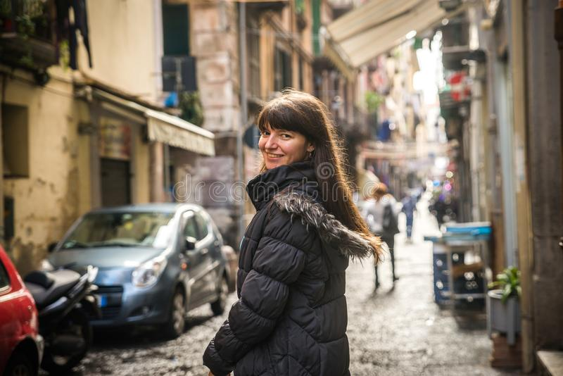 Tourist girl in Naples. On the crowded, busy streets, Italy. Watching the camera stock photography