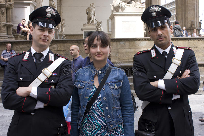 Tourist Girl With Policemen In Florence Editorial Photo