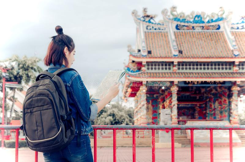 Tourist girl`s hold a map and looking at view Travel location Cu. Ltural and smiling on the day trip stock photos