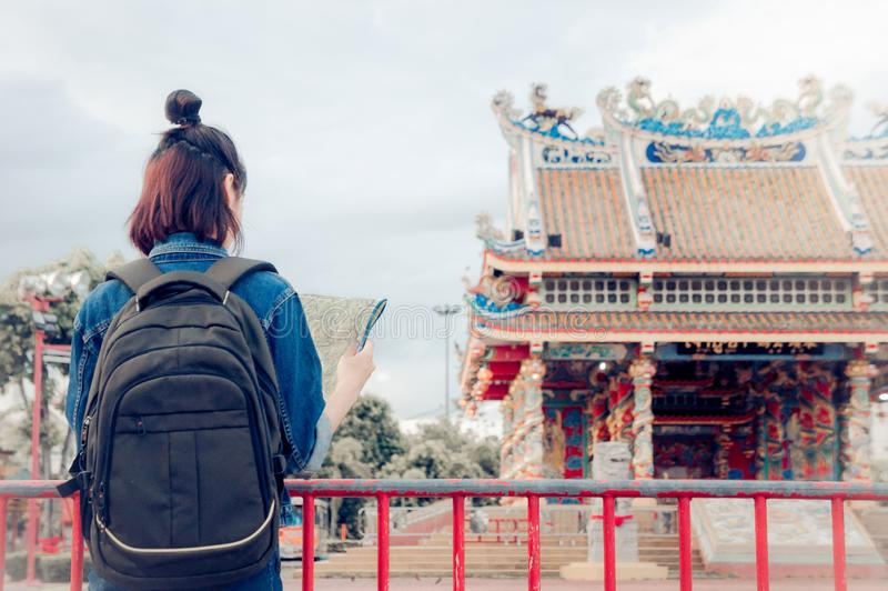 Tourist girl`s hold a map and looking at view Travel location Cultural and smiling on the day trip.  royalty free stock photography
