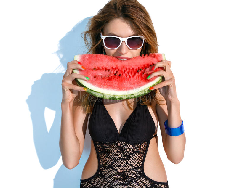 Tourist girl with a slice of watermelon royalty free stock photography