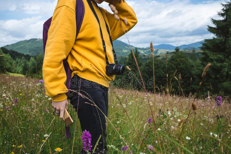 Tourist girl standing at  the meadow royalty free stock photo