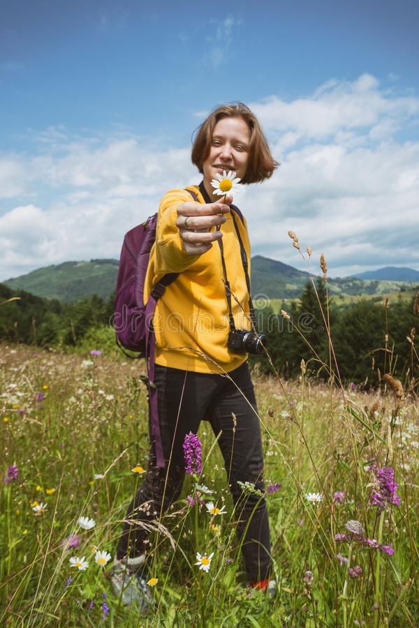 Tourist girl standing at  the meadow royalty free stock photography