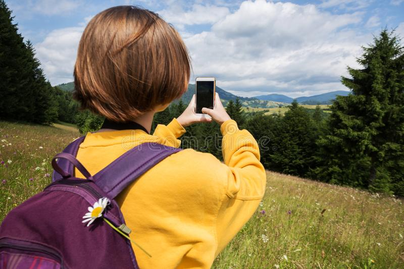 Tourist girl standing at  the meadow royalty free stock photos