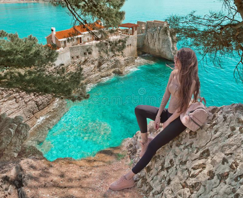 Tourist girl visiting Montenegro. Traveller sightseeing Old Venetian Castello Fortress is attraction symbol of the Montenegrin to stock image