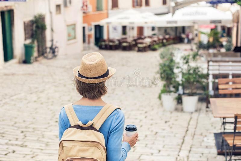 Tourist girl walking in the city during vacation. Cheerful woman traveling abroad in summer. Travel and active lifestyle concept stock image