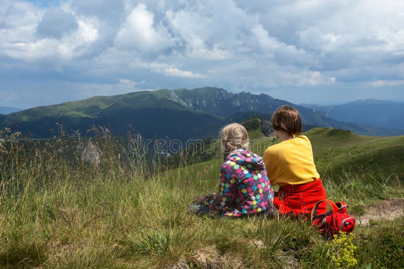 tourist girls relax in mountains royalty free stock photography