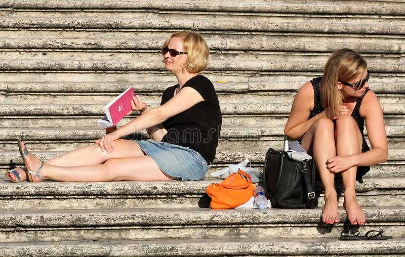 Tourist girls relaxing in Rome royalty free stock photography
