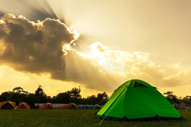 Tourist green camping tent on the campground. Tourist green camping tent front of front of rental tents on the grass at campground of Phu Kradung National Park royalty free stock photo