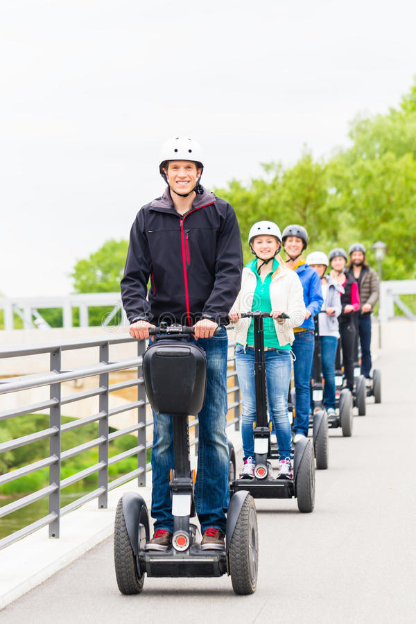 Tourist group driving Segway at sightseeing tour. Tourist group having guided Segway city tour in Germany royalty free stock images