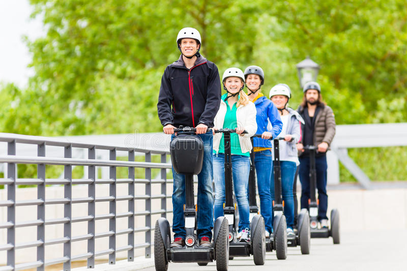 Tourist group driving Segway at sightseeing tour. Tourist group having guided Segway city tour in Germany stock image