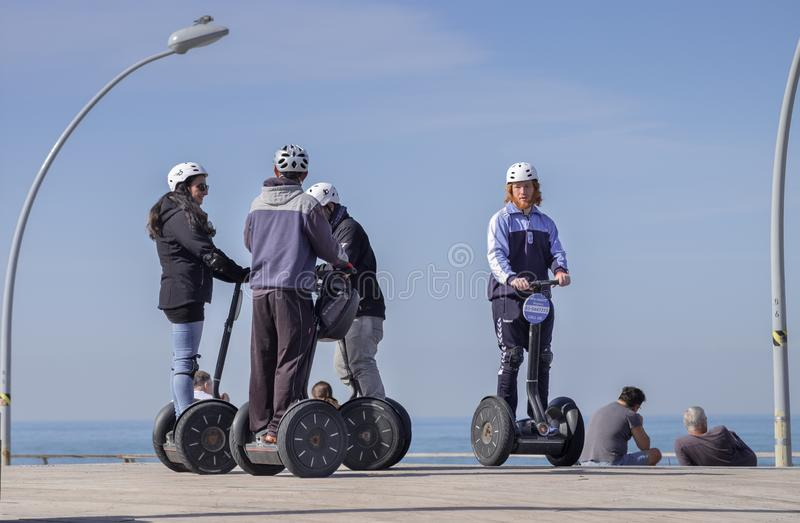 Tourist group having Segway city tour at wooden boardwalk in Tel-Aviv royalty free stock images