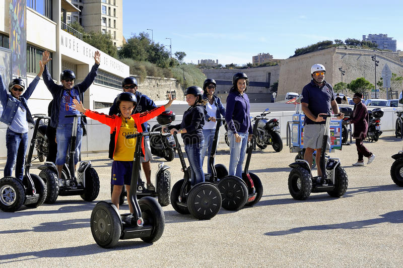 Tourist group moving Segway stock image