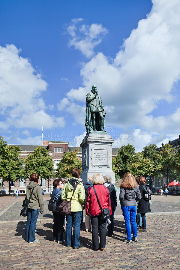 Tourist group at statue King William I, The Hague, Netherlands royalty free stock photos