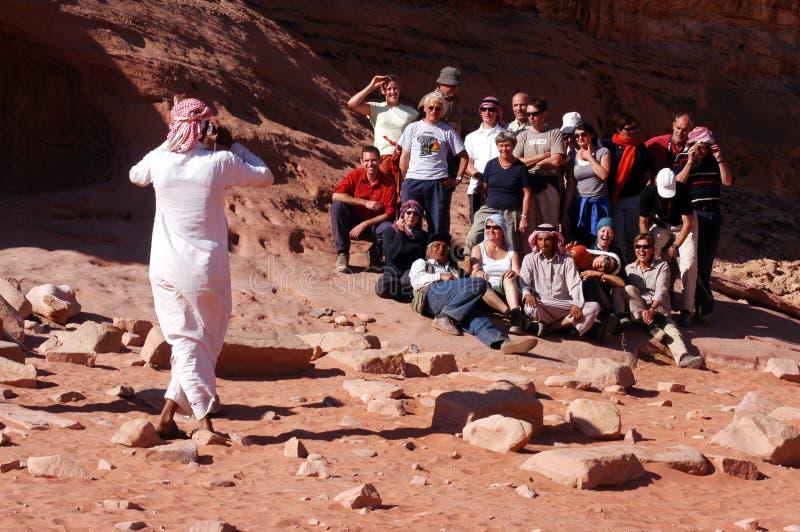 Tourist group visit Wadi Rum Jordan. WADI RUM, JOR-NOV 10 2007:Tourist group in Wadi Rum,Jordan.In 2010, over 8 million tourists from various countries visited royalty free stock photos