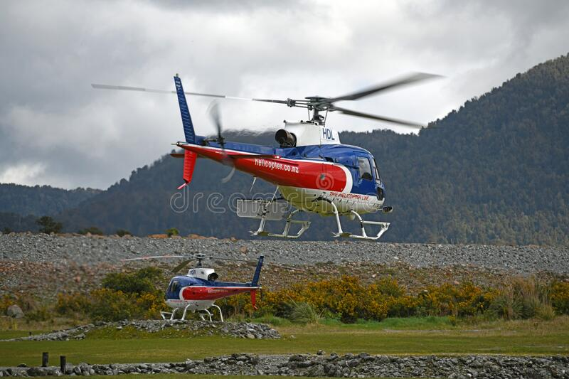 Tourist helicopters at Franz Josef stock image