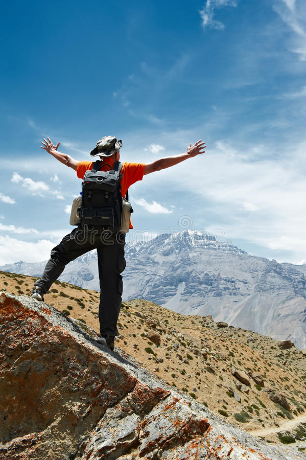 Tourist Hiker With Map In Mountains Stock Image