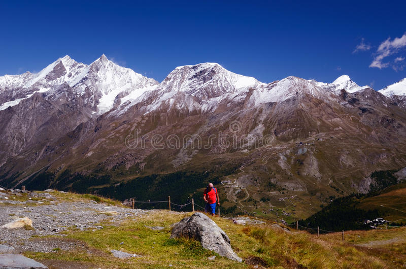 Tourist Hiking in Swiss Alps stock image