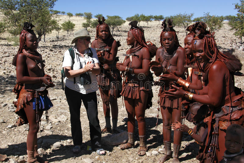 Tourist and Himba nomadic tribe - Namibia royalty free stock photography