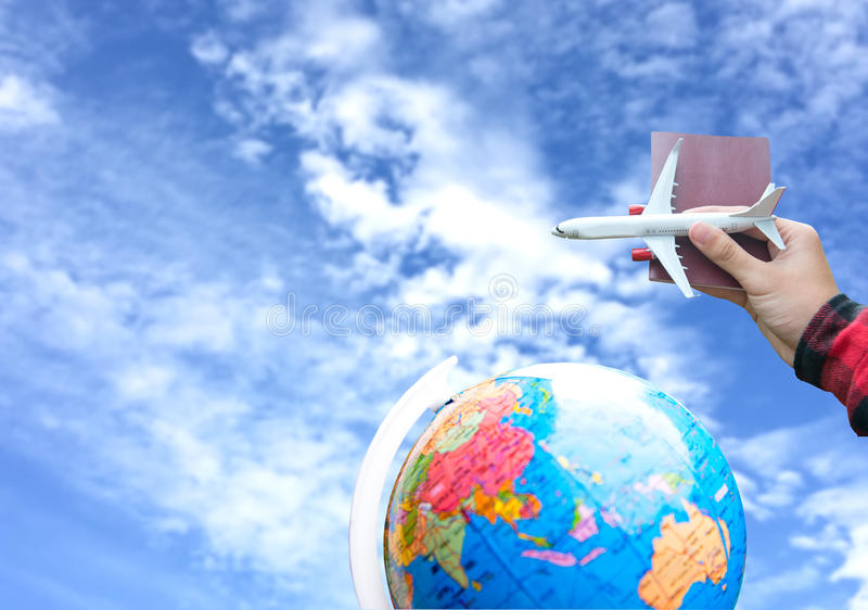 Tourist holding airplane flight travel and passport traveller fly travelling citizenship air on blue sky background. Travel Concept royalty free stock photography