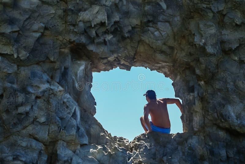 Tourist in the hole of Sail rock in Praskoveevka near Gelendzhik. Krasnodar Krai stock photography