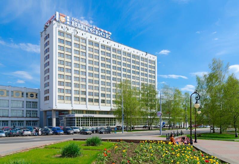Tourist and hotel complex Vitebsk Hotel, Belarus. VITEBSK, BELARUS - MAY 15, 2017: Unknown people walk down street near tourist and hotel complex `Vitebsk Hotel royalty free stock photo
