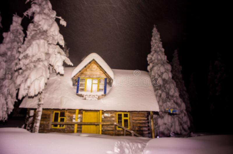 Tourist house in the winter mountains. Night in the forest. royalty free stock image