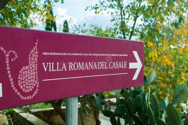 Tourist info signs. Red tourist info sign at the entrance of the famous Villa romana del Casale in Piazza Armerina, Sicily stock image