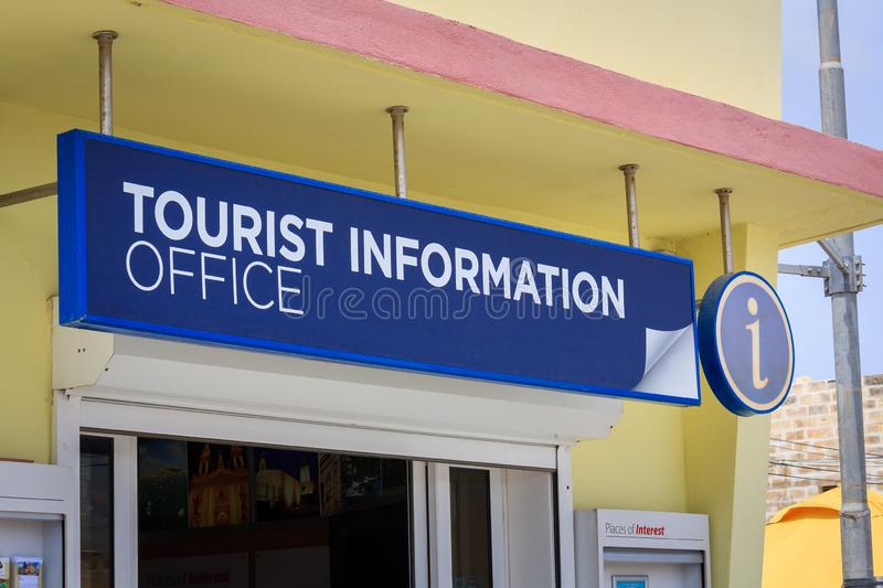 Tourist information office sign. Blue tourist information sign in front of building on Mediterranean island of Malta stock photo