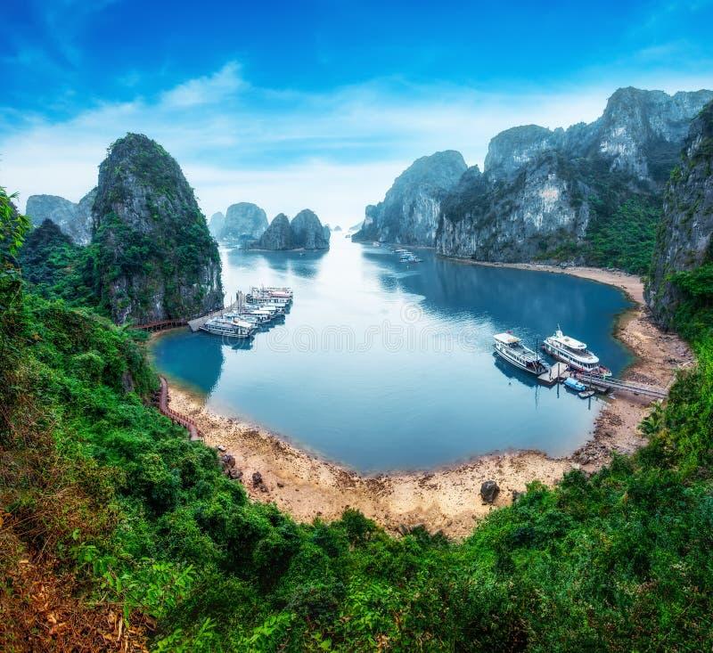 Tourist junks at Ha Long Bay, Vietnam. Tourist junks floating among limestone rocks at Ha Long Bay, South China Sea, Vietnam, Southeast Asia royalty free stock photos