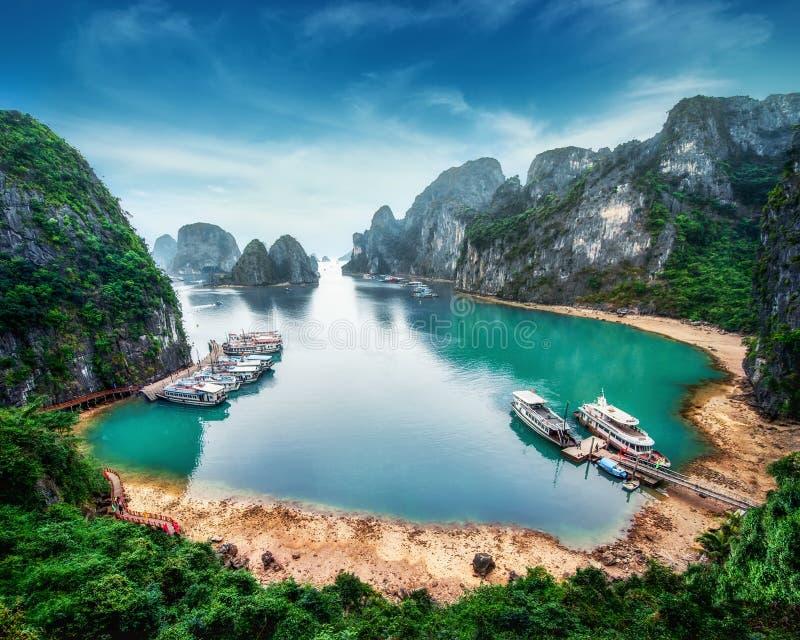 Tourist junks at Ha Long Bay, Vietnam. Tourist junks floating among limestone rocks at Ha Long Bay, South China Sea, Vietnam, Southeast Asia stock photography