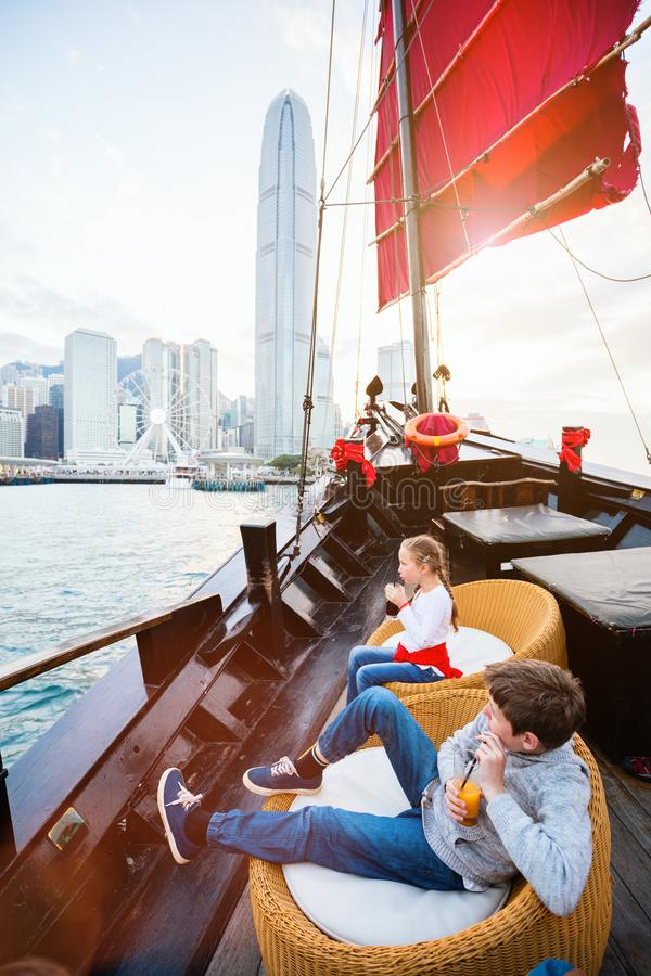 Kids in Hong Kong. Tourist kids sailing in Hong Kong harbour stock photography