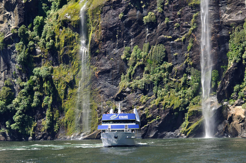 Tourist launch at Milford Sound, New Zealand royalty free stock photos