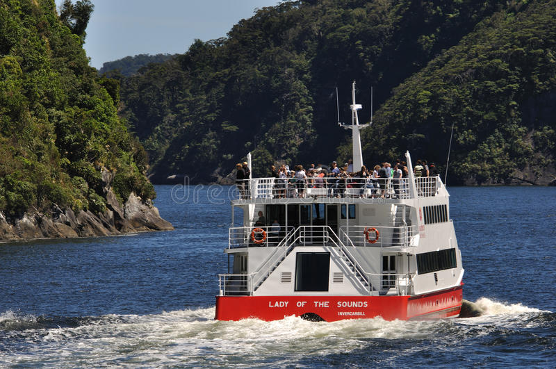 Tourist launch at Milford Sound, New Zealand stock photo