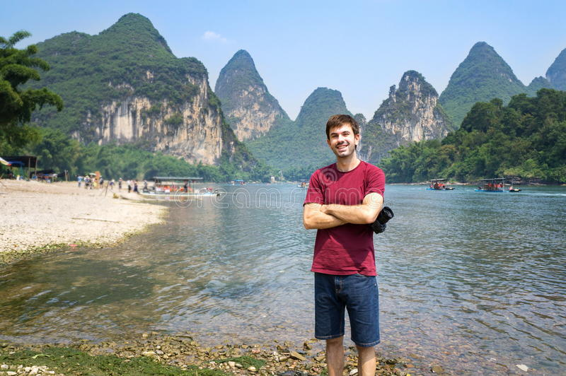 Tourist by the Li river in Yangshuo, China royalty free stock photography