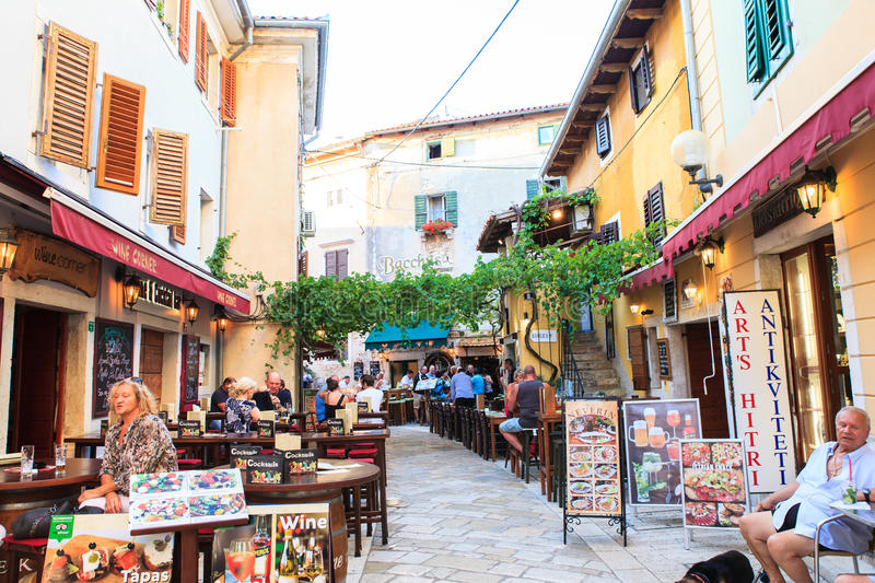 Tourist life in Porec. POREC, CROATIA - JULY, 14: View of restaurants, pubs and bars in the center town on July 14, 2017 stock image