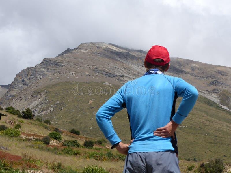 Tourist looking up to Pisang Peak royalty free stock image