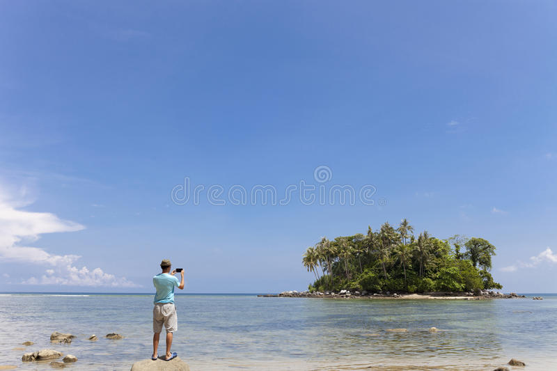 Tourist man standing on the stone in summer season and take a ph stock photos