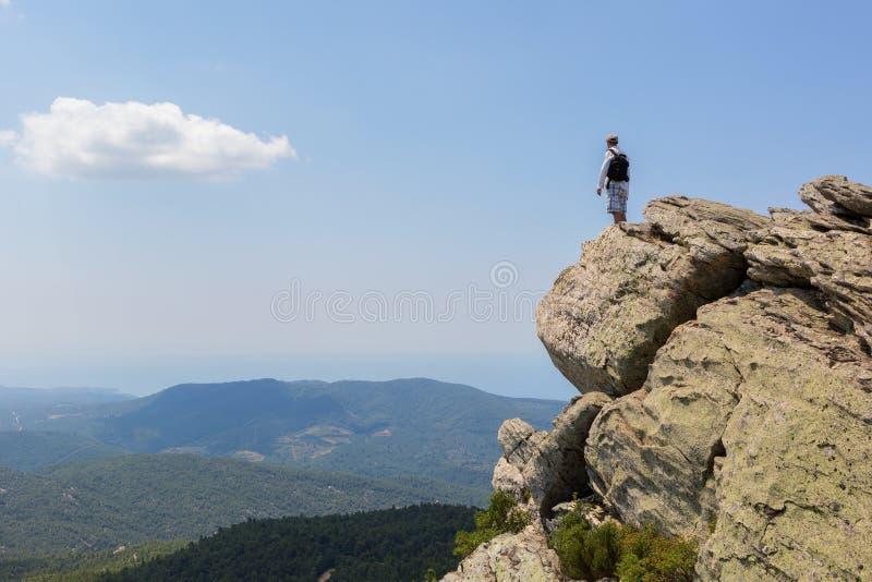 Tourist man on top of high mountains of peninsula Sithonia stock photo