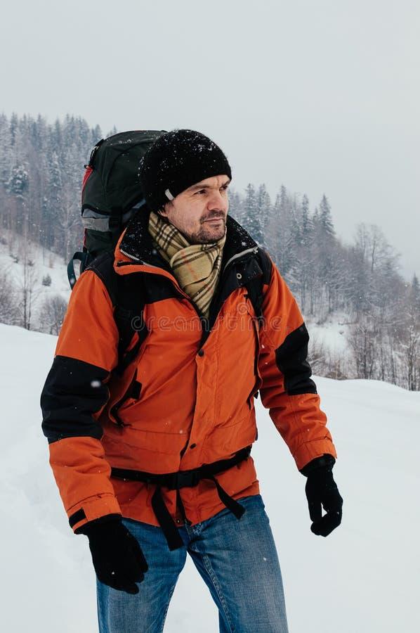 Tourist walking in snow mountain landscape stock photo