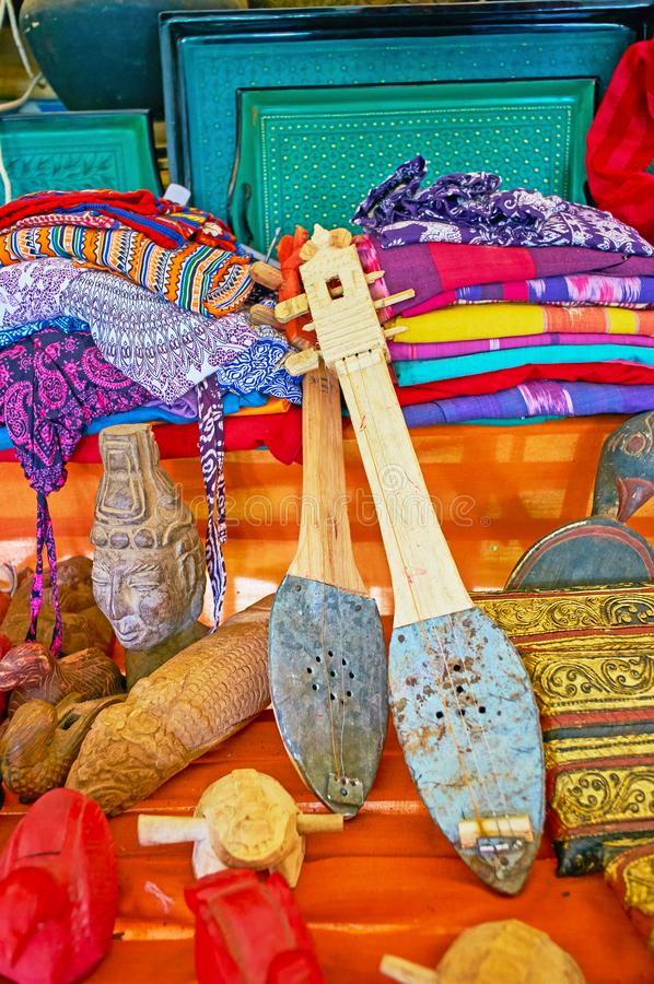 The gifts from Indein souvenir market, Inle Lake, Myanmar. The tourist market of Inn Thein Indein village boasts different souvenirs, such as authentic musical stock photo